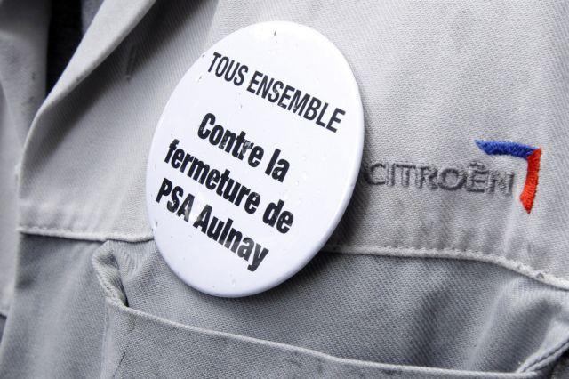 Γαλλία: Στους δρόμους οι εργαζόμενοι της Peugeot Citroen | tovima.gr