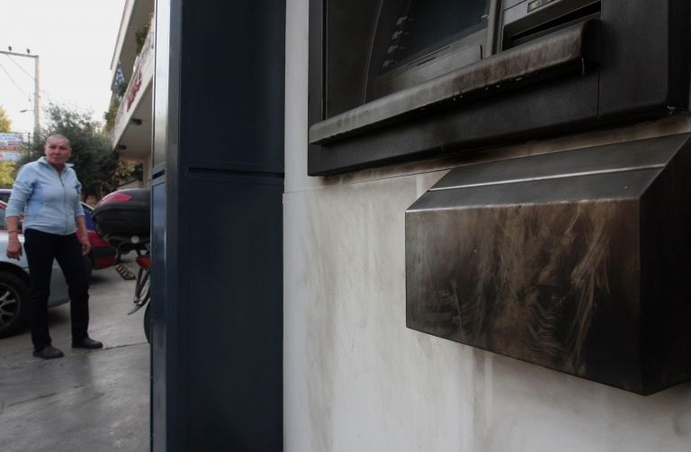 Alpha Bank ATM and store entrance damaged in bomb attack | tovima.gr