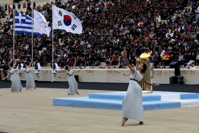 Παραδόθηκε η Ολυμπιακή Φλόγα στους νοτιοκορεάτες διοργανωτές   tovima.gr