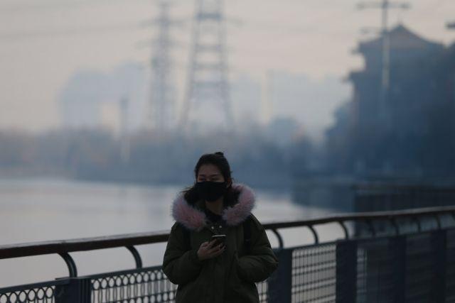 Πορτοκαλί συναγερμός λόγω νέφους στην Κίνα | tovima.gr