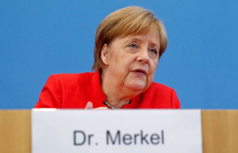 Merkel welcomes end of bailout programme, says its impact will continue | tovima.gr