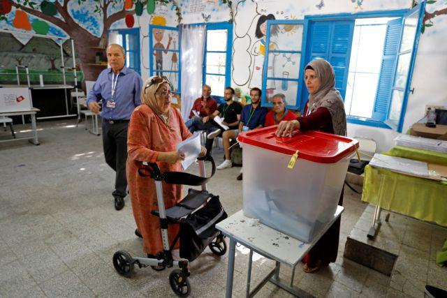 Άνοιξαν οι κάλπες στην Τυνησία : Τρίτες βουλευτικές εκλογές μετά την επανάσταση του 2011 | tovima.gr