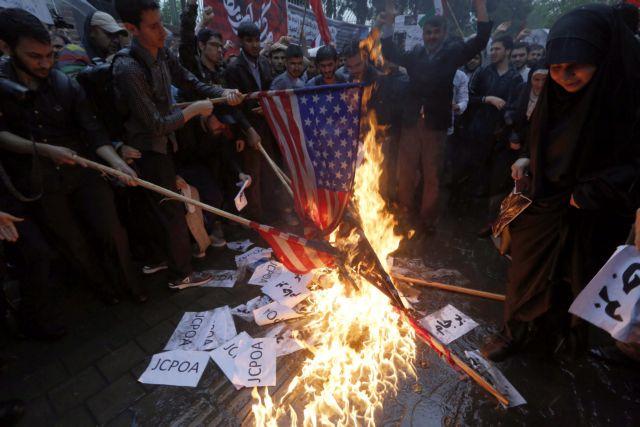 Ιράν: Εταιρεία φτιάχνει και πουλά σημαίες για… κάψιμο | tovima.gr